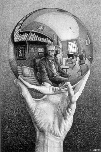 Hand holding reflecting sphere